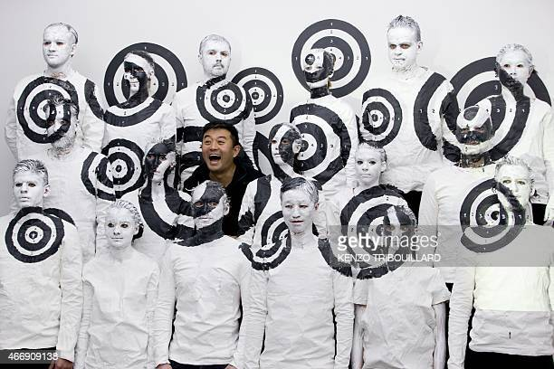 Chinese artist Liu Bolin takes part in a performance on March 19 2015 in Paris CAPTION