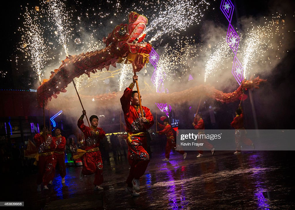 Chinese artists perform a dragon dance at a local amusement park during celebrations for the Lunar New Year February 19, 2015 in Beijing, China.The Chinese Lunar New Year of the Sheep also known as the Spring Festival, which is based on the Lunisolar Chinese calendar, is celebrated from the first day of the first month of the lunar year and ends with Lantern Festival on the Fifteenth day.