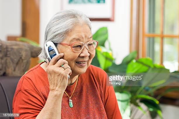 Chinese Asian Senior Woman Talking on Telephone, Holding Mobile Phone