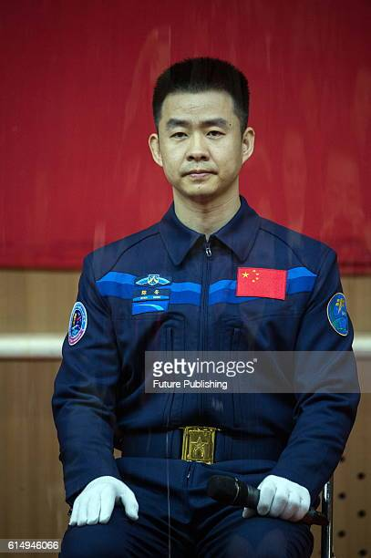 Chinese astronaut Chen Dong after the glass wall attend a presser at the Jiuquan Satellite Launch Center on October 16 2016 in Jiuquan China China...