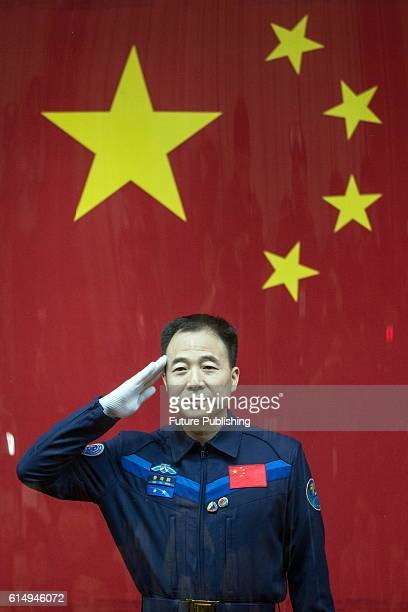 Chinese astronaut Jing Haipeng after the glass wall attend a presser at the Jiuquan Satellite Launch Center on October 16 2016 in Jiuquan China China...
