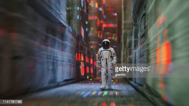 chinese astronaut walking in futuristic city - space station stock pictures, royalty-free photos & images