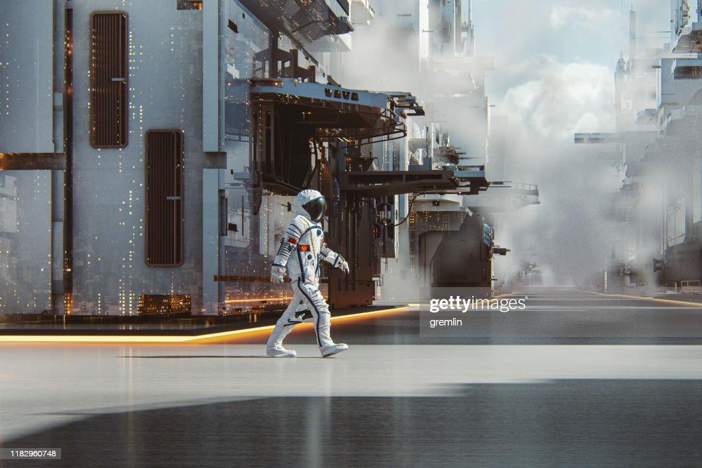 Chinese astronaut walking in futuristic city : Stock Photo