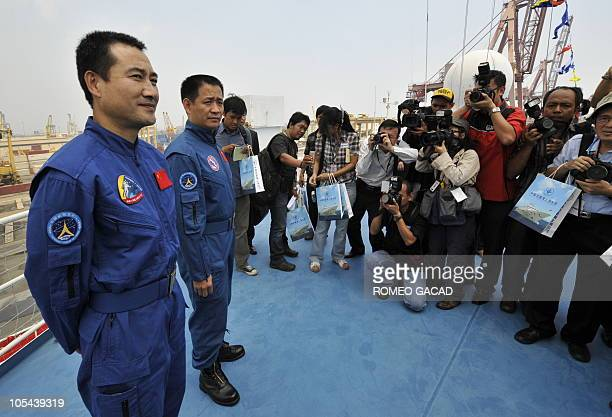 Chinese astronauts Zhai Zhigang and Nie Haisheng and Zhai Zhigang face journalists from the deck of the Chinese satellite monitoring ship MV...