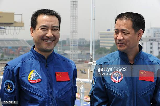 Chinese astronauts Zhai Zhigang and Nie Haisheng face journalists on the deck of the Chinese satellite monitoring ship MV Yuanwang5 on arrival at the...