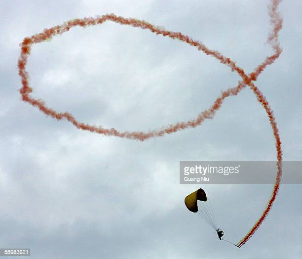Chinese athlete performs a parachute jump during the opening ceremony of the China Aero Sports Games October 22 2005 in Nantong of Jiangsu province...
