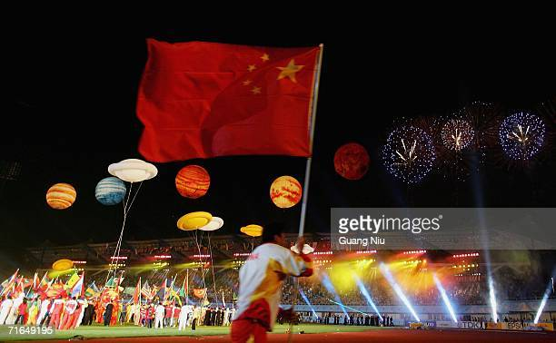 Chinese athlete runs with a national flag during the opening ceremony for 11th World Junior Championships at Chaoyang Sports Centre on August 15 2006...