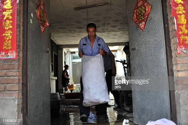 Chinese authorities seize bags of rice dumplings which were made from contaminated rice with sodium cyclamate an illegal artificial sweetener at an...