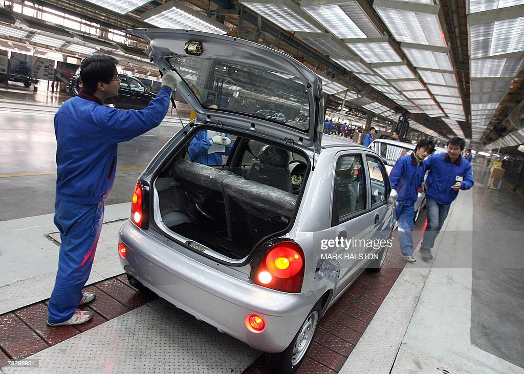 Chinese automotive workers check Chery Q Pictures | Getty Images