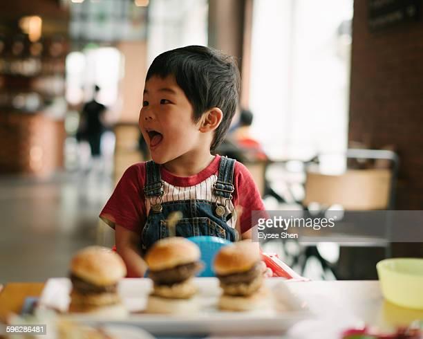 Chinese baby boy & humburger