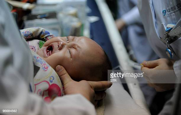 Chinese baby cries as he gets treatment for flu at a hospital in Hefei, east China's Anhui province on January 8, 2010. Children are susceptible to...