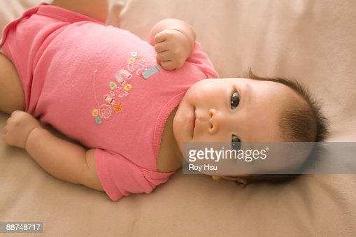 Chinese Baby Girl Laying On Bed Stock Photo Getty Images