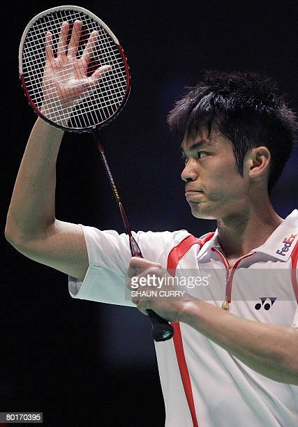 Chinese badminton player Dan Lin celebrates after beating China's Bao Chunlai in the semifinals mens singles game during the Yonex All England Open...