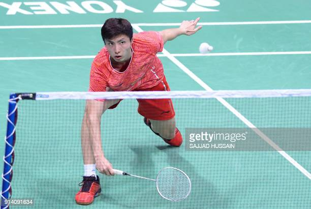 TOPSHOT Chinese badminton player Shi Yuqi plays a return against Taiwanese badminton player Chou Tien Chen during their men's singles final badminton...