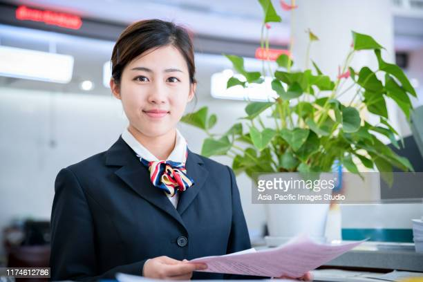 a chinese bank teller and retail bank interior. - bank financial building stock pictures, royalty-free photos & images