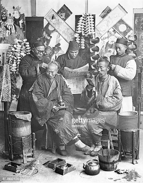 Chinese barber shop Two men receiving haircuts