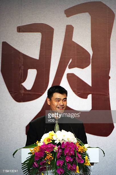 Chinese basketball player Yao Ming arrives at his press conference announcing his retirement from basketball on July 20 2011 in Shanghai China