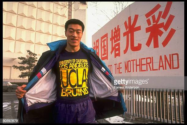 Chinese basketball star Ma Jian sporting UCLA Bruins tshirt re winning scholarship to Amer Univ outside by do credit to Motherland banner