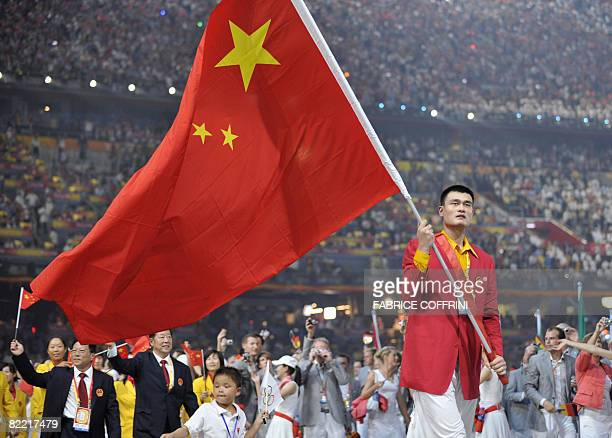 Chinese basketball star Yao Ming leads the Chinese delegation during the opening ceremony of the 2008 Beijing Olympic Games in Beijing on August 8...