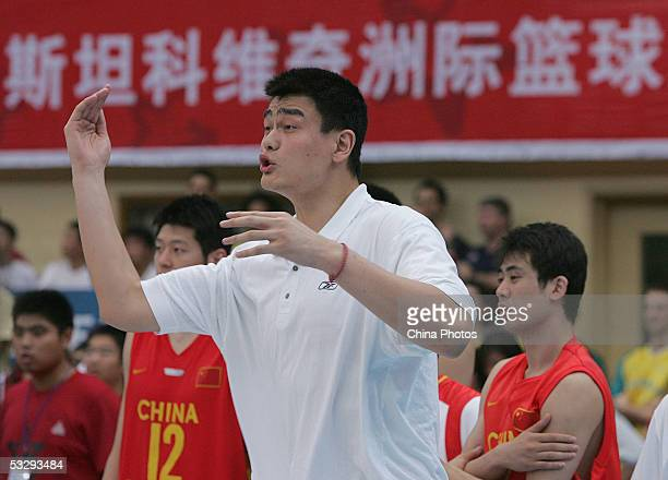 Chinese basketball star Yao Ming watches a match between China and Lithuania in the Stankovic Continental Champions Cup at Beijing Capital's...