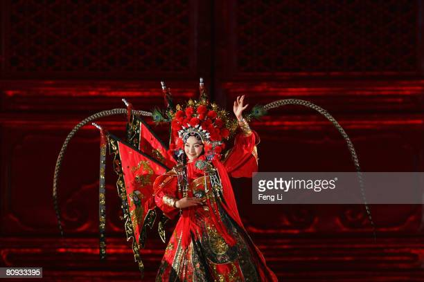 Chinese Beijing opera performer performs during the Award-giving Ceremony for the 4th Olympic Songs Competition at the illuminated Worker People's...