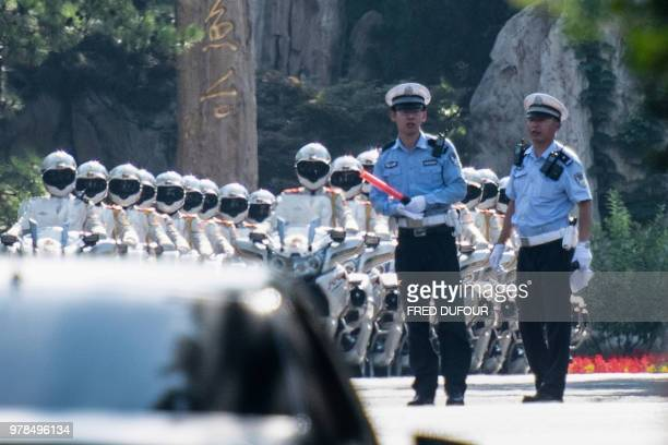Chinese bikers honour guards prepare to escort the car believed to be carrying North Korean leader Kim Jong Un at the Diaoyutai State Guest house...