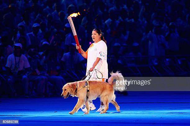 Chinese blind torchbearer Ping Yali enter the stadium during the Opening Ceremony for the 2008 Paralympic Games at the National Stadium on September...