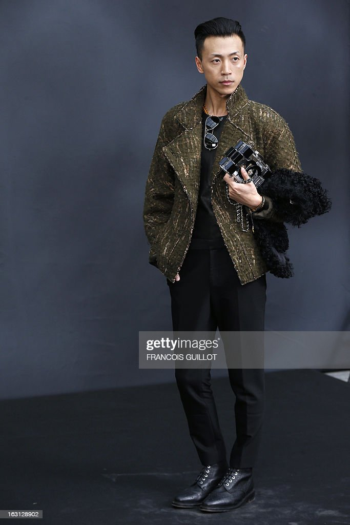 Chinese blogger Han Huo Huo poses on March 5, 2013 as he arrives to attend Chanel's Fall/Winter 2013-2014 ready-to-wear collection show at the Grand Palais in Paris.