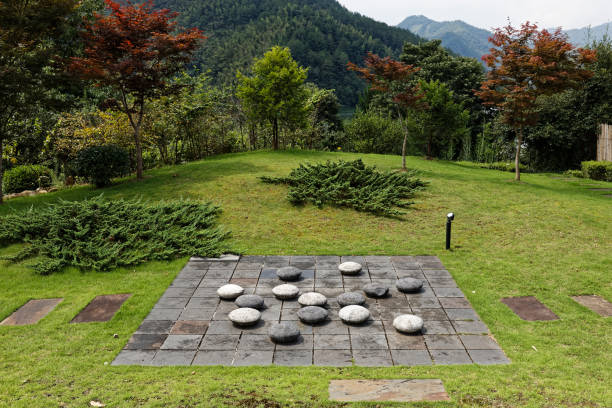 """Chinese board game """"Wei Qi (Go)"""" on island in Fengle Reservoir."""