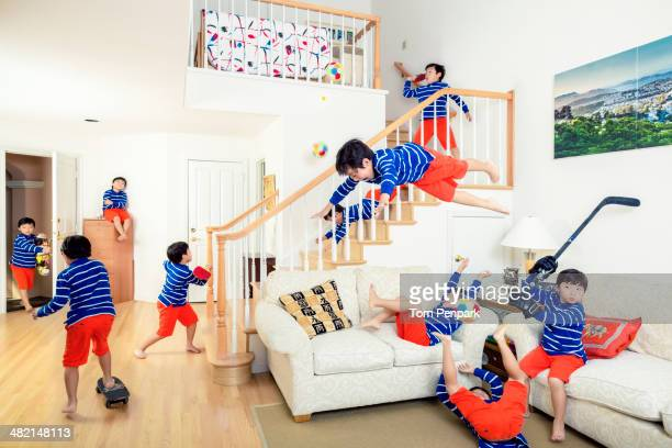 Chinese boy climbing all over house