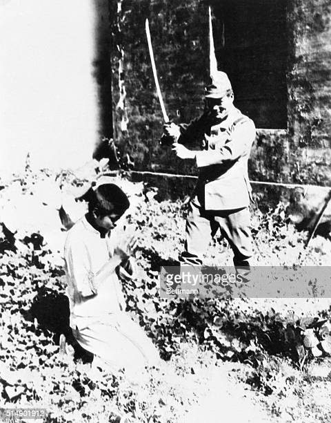 A Chinese boy is beheaded his only crime was being a member of a household suspected by Japs of aiding Chinese guerillas