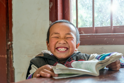 Chinese Boy with big smile at school,looking at camera 503467768