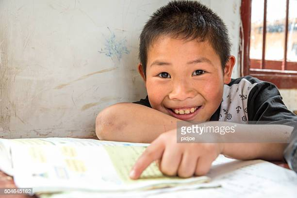 Chinese Boy with big smile at school,looking at camera