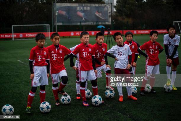 Chinese boys in jerseys of Germany's Bundesliga club Bayern Munich take part in a practice session after the opening ceremony of Bayern's office in...