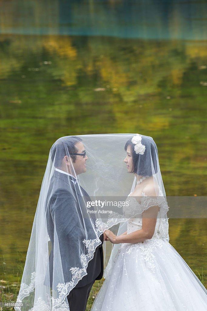 Chinese bride & groom, Jiuzhaigou National Park : Stock Photo