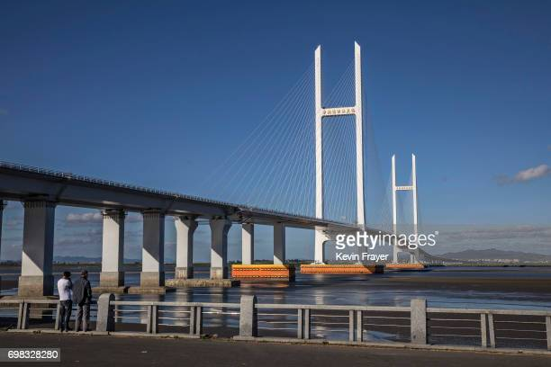 Chinese bridge which was completed more than five years ago is seen on the Yalu river from the border city of Dandong, Liaoning province, northern...