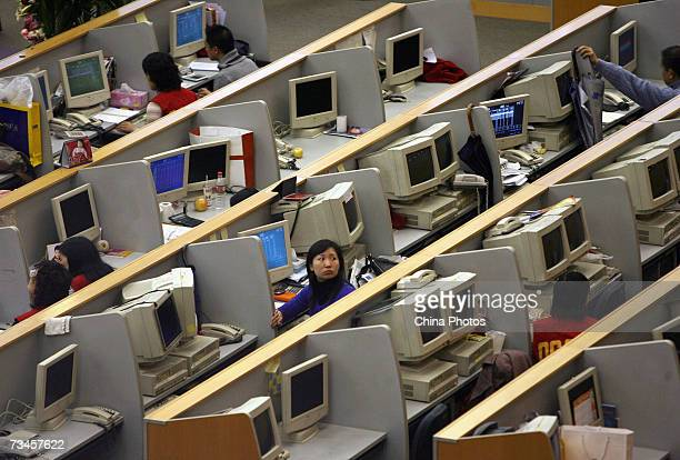 Chinese brokers work inside the Shanghai Stock Exchange on March 1 2007 in Shanghai China China's stock market experienced its sharpest daily fall in...