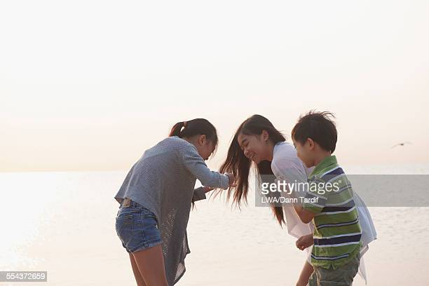 chinese brother and sisters playing outdoors - 7894 stock pictures, royalty-free photos & images
