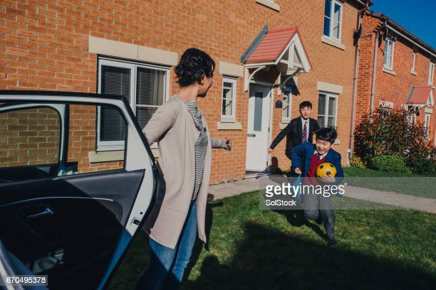 chinese brothers rushing to school! - british granny stock photos and pictures