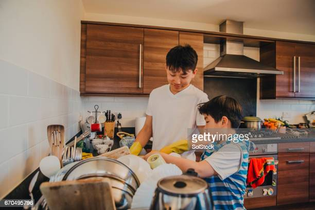 Chinese Brothers Washing Up