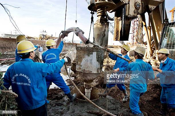 Chinese building workers at the construction site of the Al Mogran Project on January 10 2007 in Khartoum Sudan Khartoum the capital of Sudan lies at...