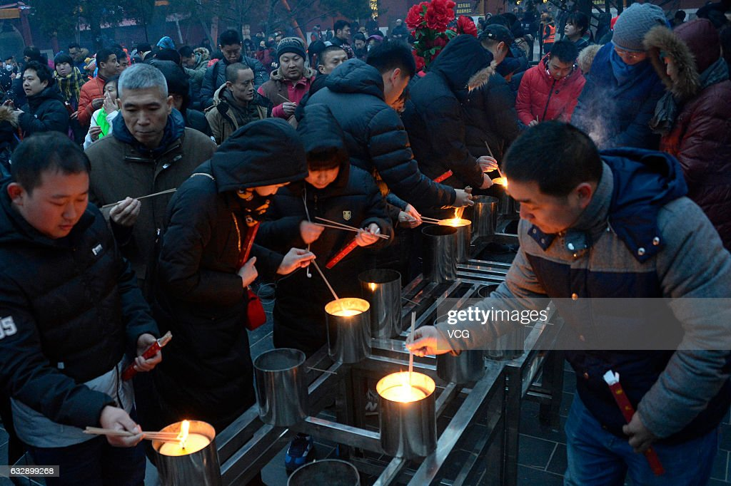 Chinese burn incense sticks to pray for good luck for the Year of