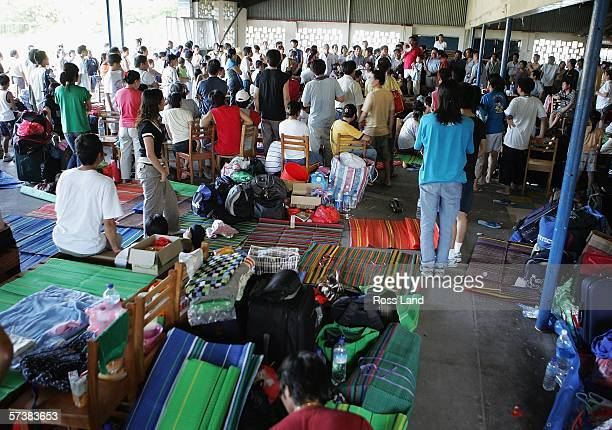 Chinese business people and their families shelter in the Police Club which has been turned into a refugee centre on April 21, 2006 in the Soloman...