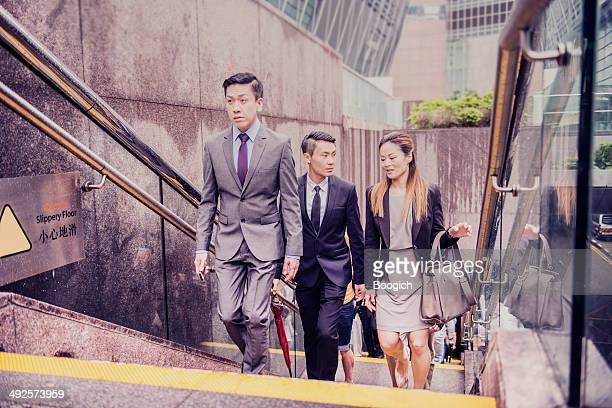 Chinese Business Team Walking Upstairs in Hong Kong Financial District