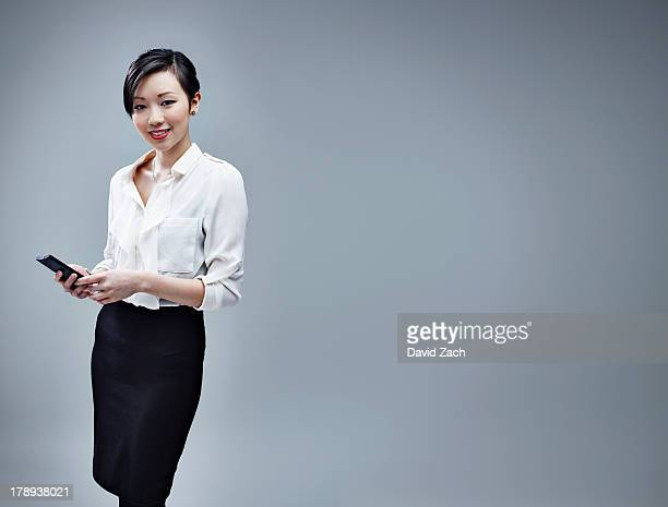 Chinese business woman using mobile phone, portrai