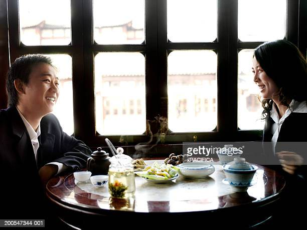 Chinese businessman and woman in traditional tea house