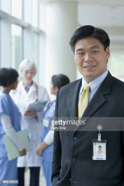 Chinese businessman in hospital with doctors and nurses