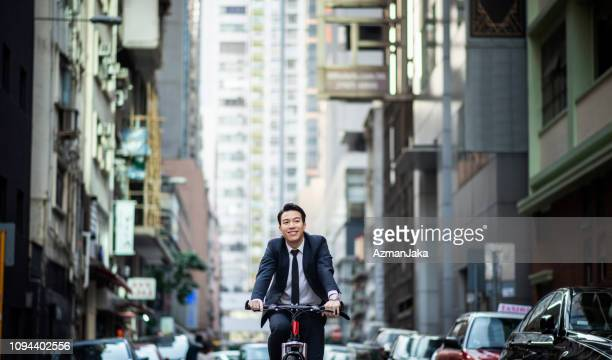 Chinese businessman riding a bike to work