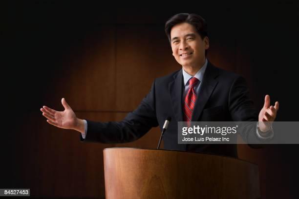 Chinese businessman speaking at podium