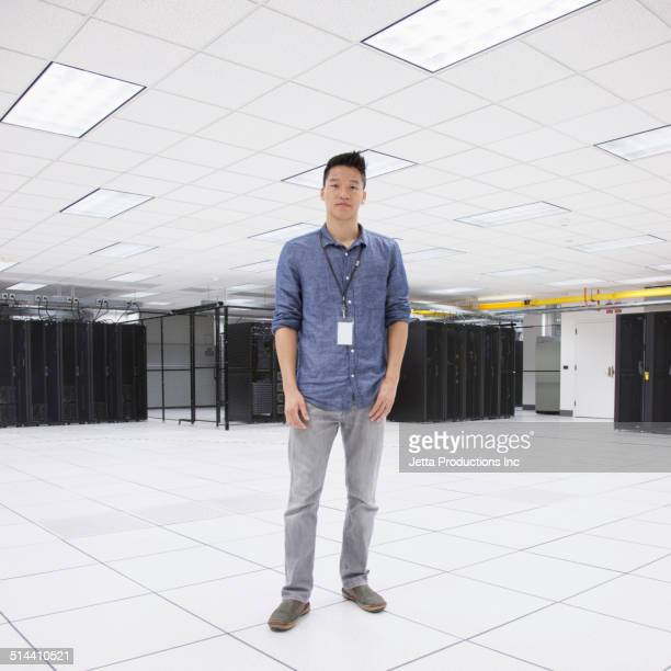 Chinese businessman standing in server room